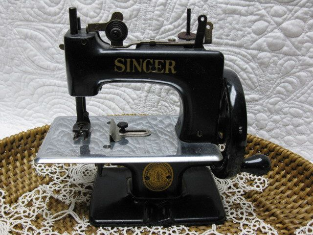 Singer Toy Sewing Machine by NestEgg on Etsy https://www.etsy.com/listing/230748320/singer-toy-sewing-machine