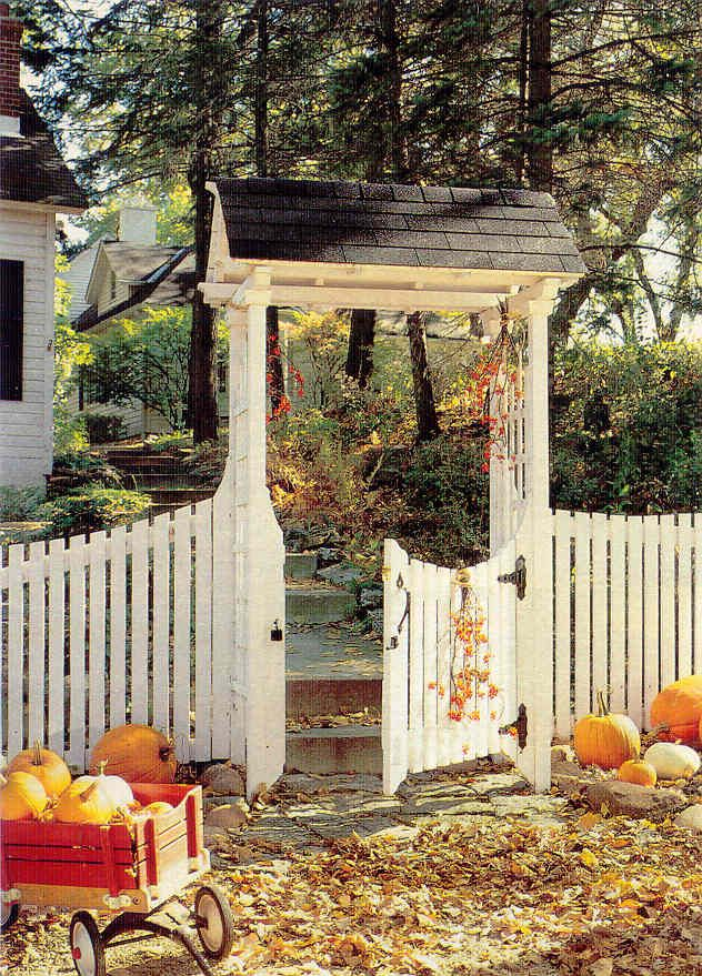 Charming cottage picket fence gate autumn pumpkins for Better homes and gardens fence ideas