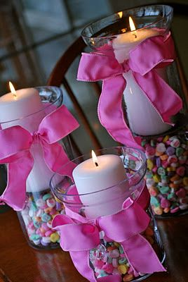 Candy Hearts in Hurricane Vases..cute for Valentines..or change to pastel M & M's for Easter. Red cinnamon or peppermint with white or red candles would also be nice for Christmas. Halloween.. corn candy and Orange or Black Candles... etc... your choices ..