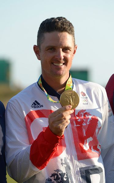 Justin Rose of Great Britain celebrates with the gold medal after the final…