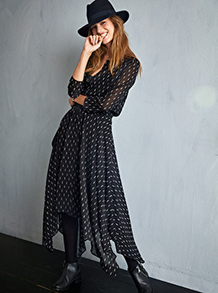 "Easy to wear and simple to style, this floaty dress with a flattering shirred waist will become your go-to for week to weekend style. Just add our Hampshire ankle boots. •Semi sheer fabric with detachable inner lining. •Shirred elasticated waistband. •Round neck with split V and 3/4 length sleeves. •Midi length with asymmetric hem. •Model is 5'11"" and wears size 8."