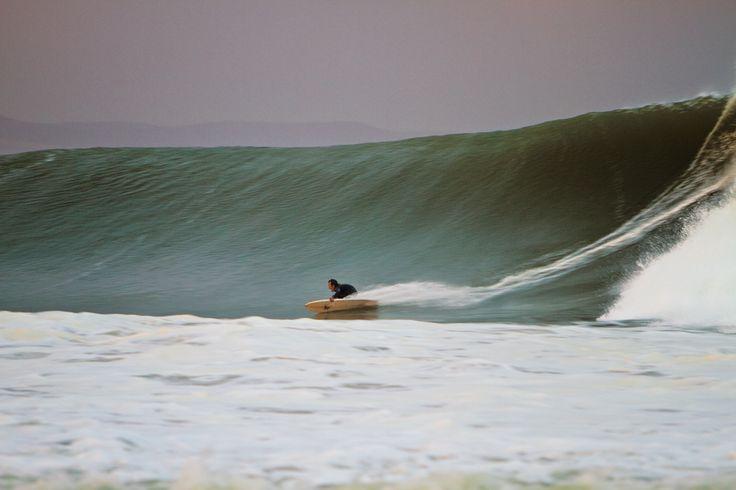 Derek Hynd reaching terminal velocity on a wide-open wall at J-Bay. Photo: Van Gysen