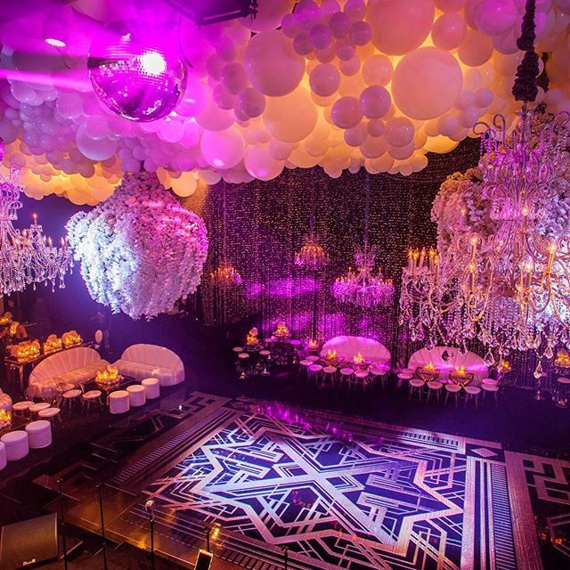 Take a step back in time.  Why not look to your favorite era to find wedding inspiration? The Kardashians channeled the roaring 20s with black and gold invitations, extravagant feather arrangements, and other Art Deco decor.