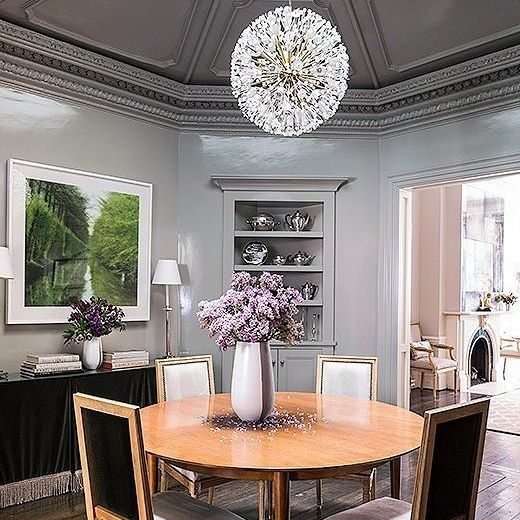 LampRoomGray In High Gloss And A Dramatic Light Fixture Create An Elevated Dining Area
