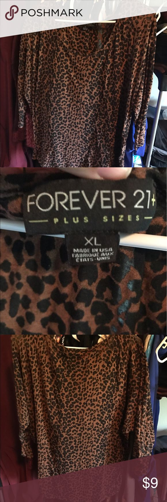 Woman's Xl Cheetah print shirt Forever 21 woman's plus size cheetah shirt. Kind of see there. Lightly worn. Willing to sale or trade. Forever 21 Tops Blouses