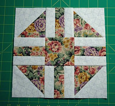 Paths & Stiles Quilt Block - Versions of the traditional Paths & Stiles quilt block have been called many names over the years. Friendship Quilt is one term used for quilts made from the block, because each quiltmaker added a signature. Light fabrics and dark fabrics were often flip flopped to create this quilt block -- envision lights where you see darks and darks where you see lights.