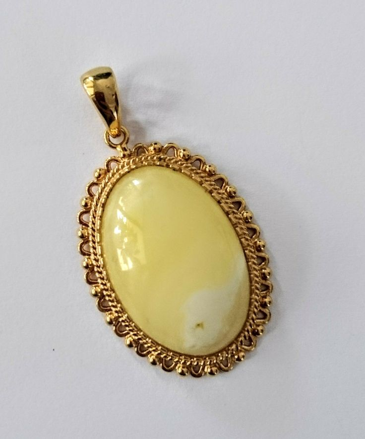 Pendant with Baltic amber, gold plated silver925