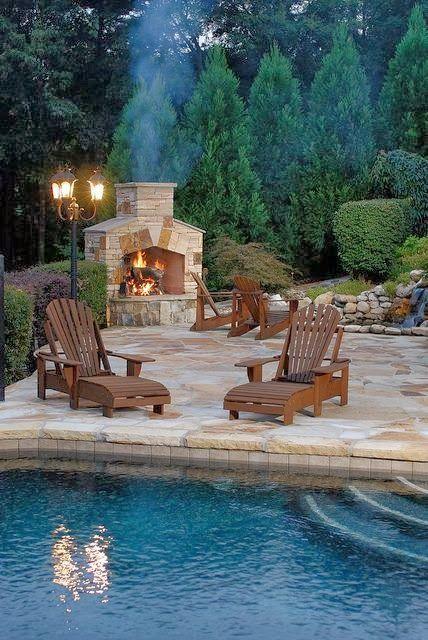 Backyard. Fireplace. Pool. Stone.