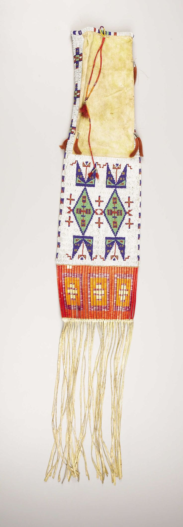 A SIOUX BEADED HIDE TOBACCO BAG. . c. 1890. ... American Indian | Lot #77163 | Heritage Auctions