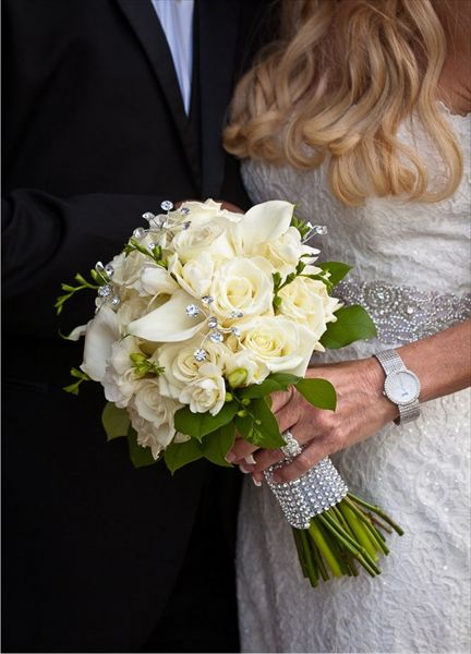 Bridal bouquet in all creams/white.  calla lilies, roses, touch of bling - rhinestone wrap!