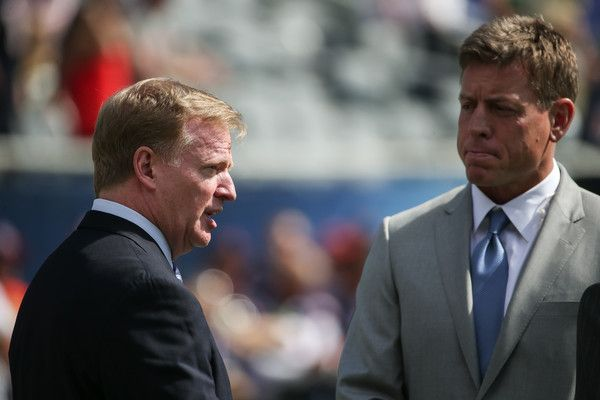 Troy Aikman Photos - Roger Goodell, Commissioner of the NFL, talks with Troy Aikman, former Dallas Cowboys quarterback, prior to the game between the Chicago Bears and the Green Bay Packers at Soldier Field on September 13, 2015 in Chicago, Illinois. - Green Bay Packers v Chicago Bears