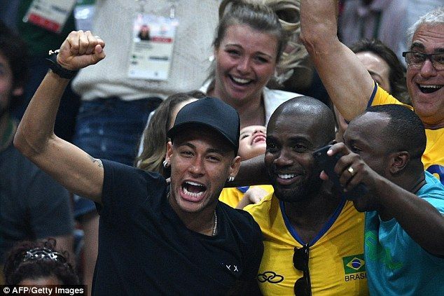 Neymar celebrates after Brazil's volleyball team won a point against Italy in…