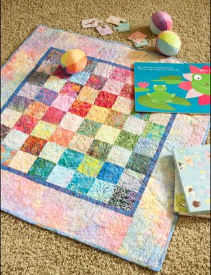 """Catch A Rainbow Baby Quilt. Made from scraps from Meryl Ann Butler's """"Catch a Rainbow"""" quilt featured in our Spring/Summer 2012 issue of Simple Quilts & Sewing."""