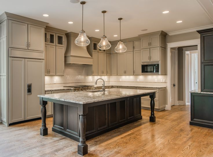 nice Large Kitchen Island Ideas #5: Like the floor to ceiling cabinets and the large island, like the lighting  above the island (although not the style of lights)