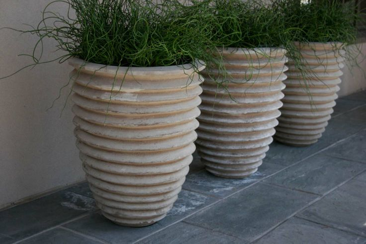 An odd number of planter with the same planting is a great focal point.