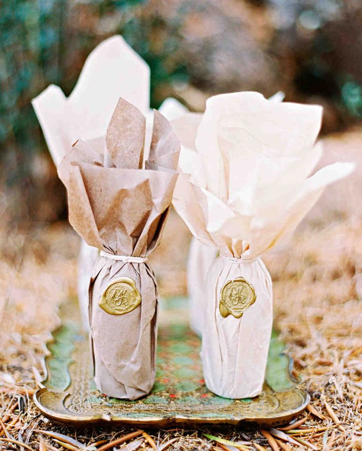 A Fruit-Filled, Floral California Wedding | Martha Stewart Weddings - Favors included bottles of local olive oil, wrapped with the couple's wax seal.