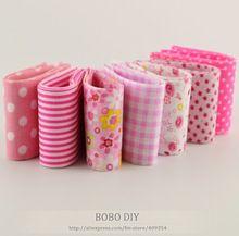 2015 nuevo 7 unids/lote 100% algodón de color rosa conjuntos de tela viajes 5 cm x 100 cm rollo de tela que acolcha de retazos de la jalea textiles de costura juguetes tildes(China (Mainland))