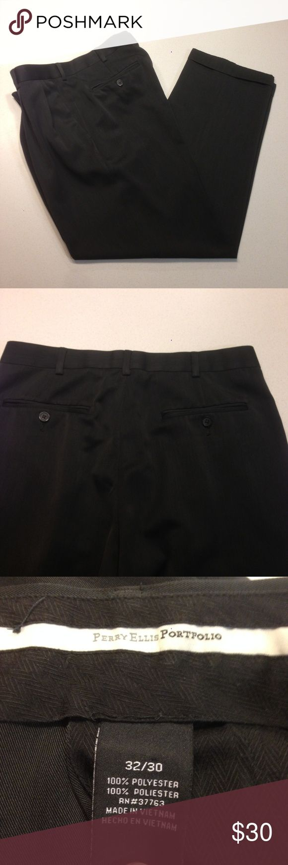 "Men's Dress Slacks EUC 32""x30"" Perry Ellis Portfolio dress slacks in excellent used condition. Double pleat classic fit melange portfolio pant. 100% polyester, Travel Luxe makes these slacks moisture wicking. Double pleated front, cuffed, double-besom back pockets with button closure. Machine washable. Dark gray/black color. 32"" x 30"". Perry Ellis Pants Dress"