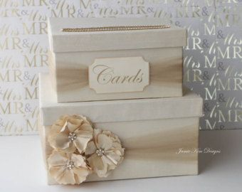 【 MODEL: MADEIRA 】  This wedding card box is beautifully made with silk shantung, satin ribbon, silk flower and rhinestones. Rhinestones around the card slot give the box a more luxurious look.  ♦ COLOR The box and premium quality double faced satin ribbon come in colors of your choice.  The silk flower come in either colors: Ivory (shown in the 1st photo), lavender (2nd photo), nude pink (4th photo), white, light pink, rose pink, coral, fuschia, red, bronze, aqua, sage, light eggplant, dark…