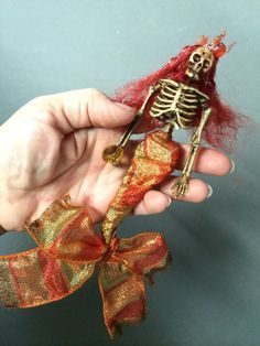 This listing is for a little handmade skeleton mermaid ornament. She is a very strange and unique Christmas or Halloween ornament for those