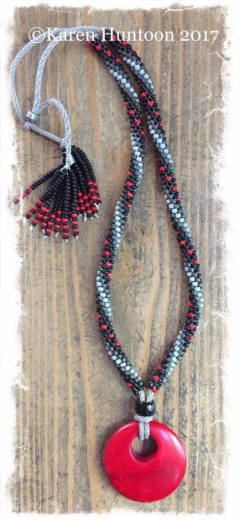 ***Beaded Necklace with Elongated Swirl, Red Pendant & Adjustable Closure