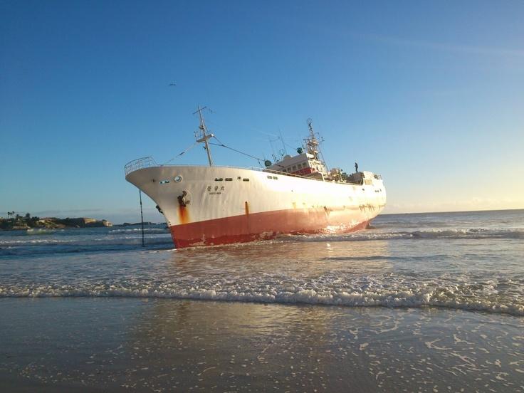 The Eihatsu Maru on the sand on Clifton Beach, Cape Town