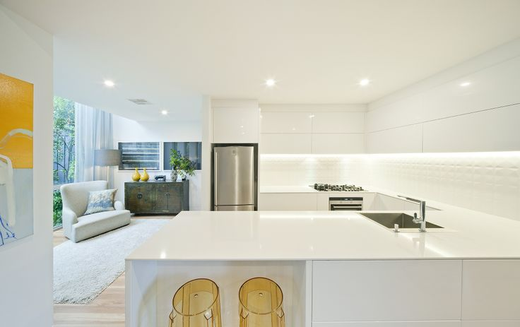 Entrant - Mint Kitchens By Designwize. Month - May. Products used - Laminex Colourtech painted doors Polar White and essastone 12mm bone white.
