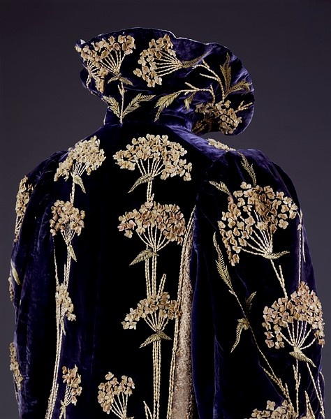 Coat  Place of origin: England, Great Britain (made)  Date: 1895-1900 (made)  Artist/Maker: Marshall & Snelgrove Ltd (maker and retailer)  Materials and Techniques: Embroidered velvet, satin, lace  Credit Line: Given by Mrs A. Poliakoff