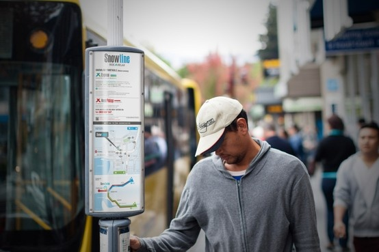 NZSki Snowline bus stop signage displaying timetable & route in downtown Queenstown