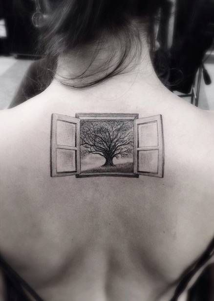 Fine line style window tattoo on the upper back. Tattoo artist:...