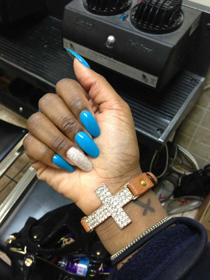 Stiletto nails ; piercing blue w/ silver glitter