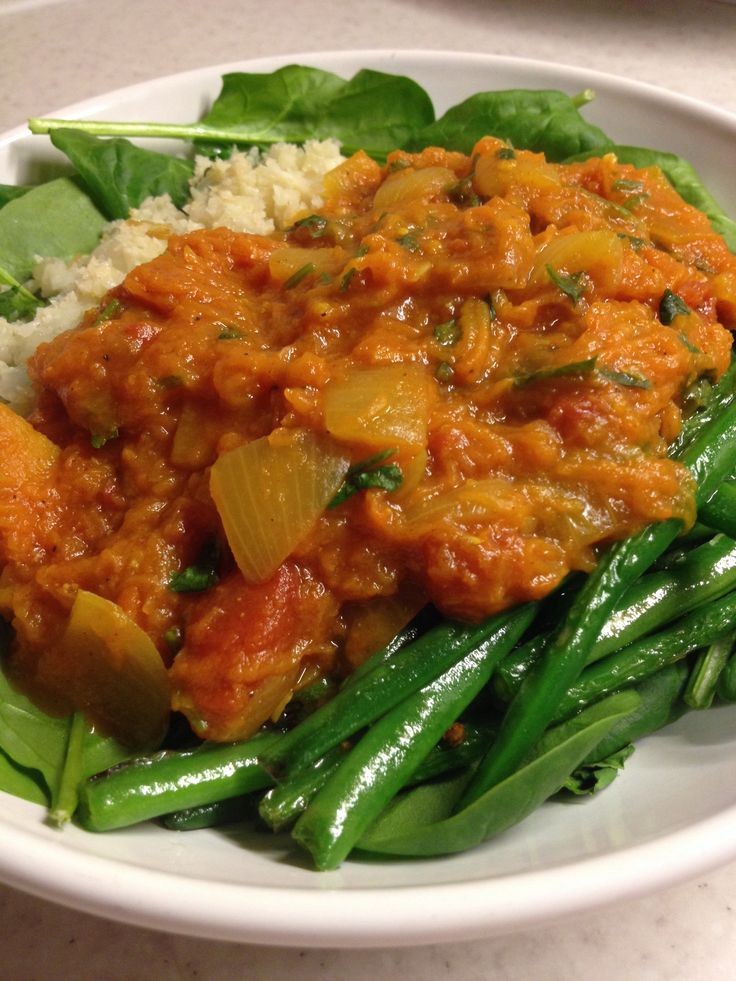 Pumpkin curry, raw spinach, garlic green beans and cauliflower pilau