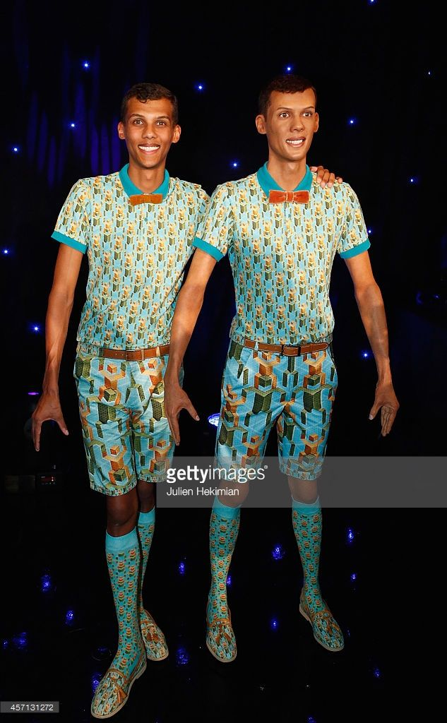 Stromae is pictured with his Wax statue at Musee Grevin on October 12, 2014 in Paris, France.