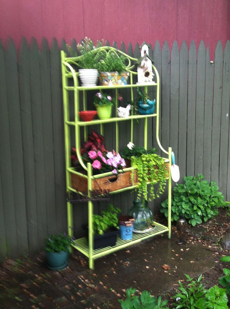 I've repurposed my old baking rack!!  Just a little plant and lot of colorful pots and some nice foliage!