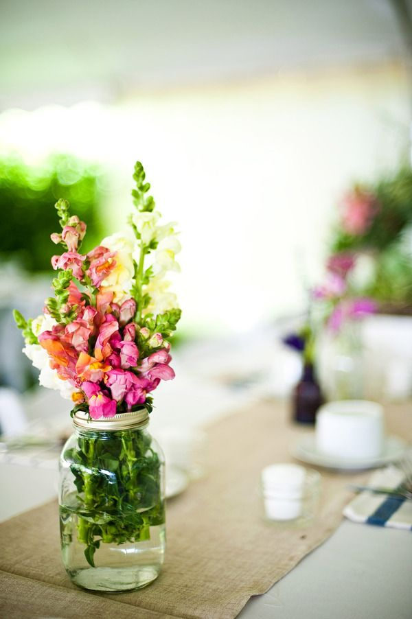 This board is turning into my flower obsession. Would it be crazy/too busy to have each table be a different flower?