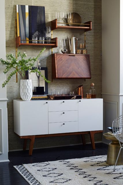 Style Your Place Like A Home Catalog — All The Tricks #refinery29  http://www.refinery29.com/2014/07/70895/west-elm-fall-2014-collection#slide11  Ditch the traditional bar cart and display the accessories on shelves above a credenza.