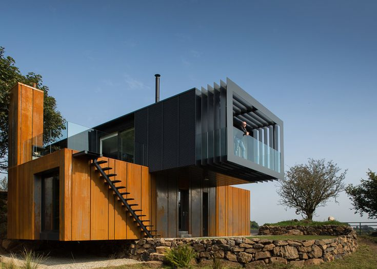 Grillagh Water House by Patrick Bradley is made up of four stacked shipping containers.