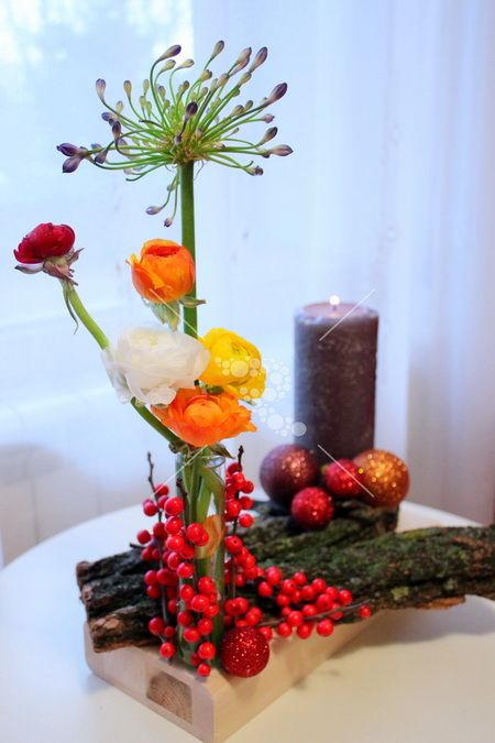 Christmas Table Centerpiece with wood elements, flowers and candle