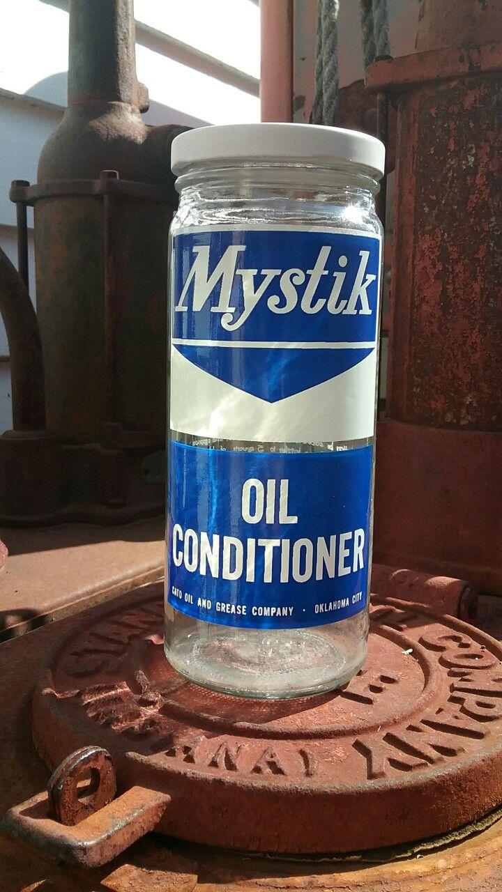 Mystik oil additive bottle.