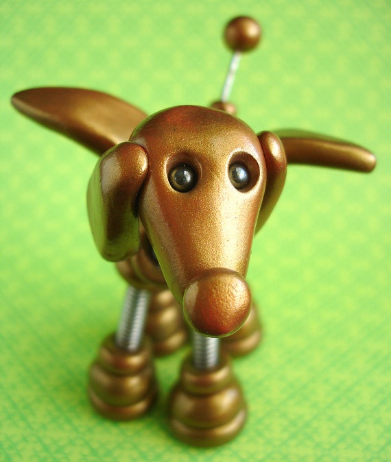 Don't let Gino go, this adorable robot dog loves to fly low, his golden coat will make your life full. Where ever he hangs it will not be dull. #polymer #clay #robot #dog #ornament
