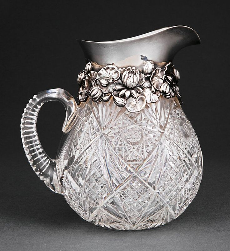 American Brilliant Period Cut Glass Pitcher with Gorham Sterling Silver.