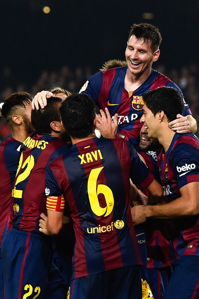 Lionel Messi of FC Barcelona celebrates with his teammates after scoring his team's fourth goal during the La Liga match between FC Barcelona and Sevilla FC at Camp Nou on November 22, 2014 in Barcelona, Catalonia. Lionel Messi beat the number of goal in the Spanish La Liga of Telmo Zarra scoring his 252nd goal.