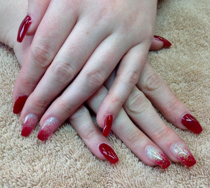 Red acrylic nails with glitter fade