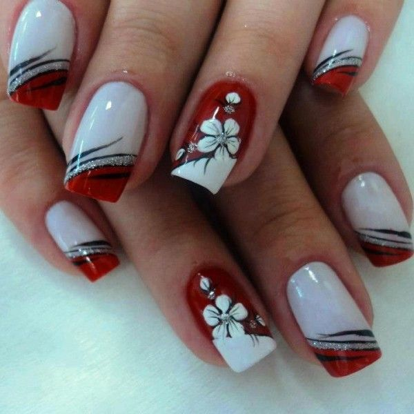 Nude nails with extended white tips and black free hand stripes, vines, or flames, black & white nail art    30 Nail Designs That We Love