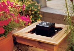 Try creating this easy tabletop fountain, made by pairing together slate and cedar. Photo by Roger Yip