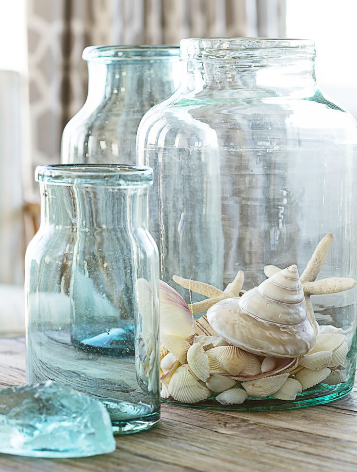 Look no farther than your natural surroundings for pretty accents. Think shells, seaglass, driftwood, or greens. - HouseBeautiful.com
