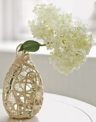 doily love continues...   lovely diy that claims to be super easy ....wrap a doily around a vase.... then add a few little stitches