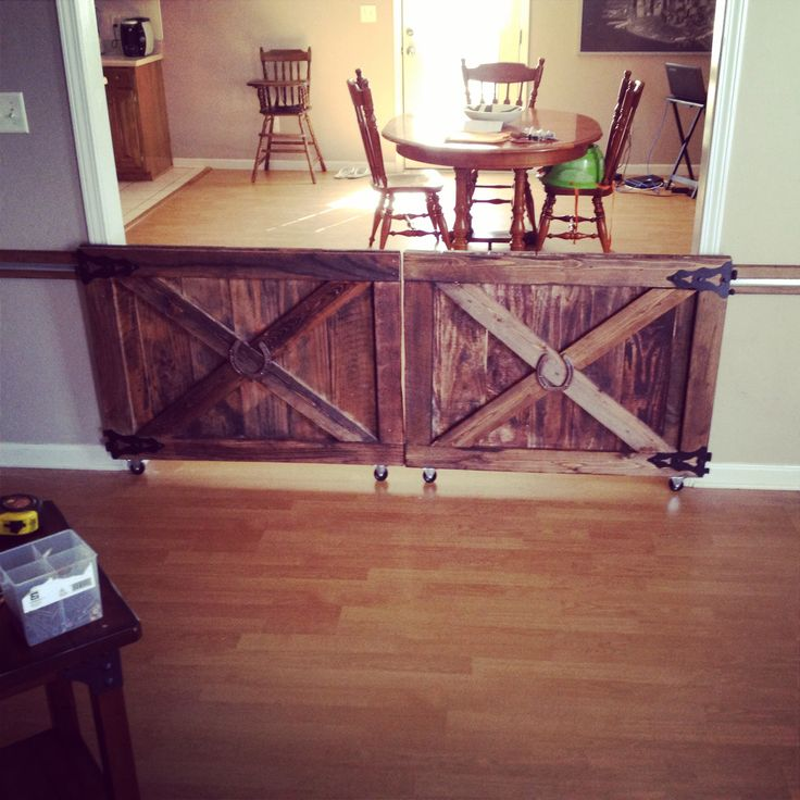 Custom made barn door rolling baby gates.