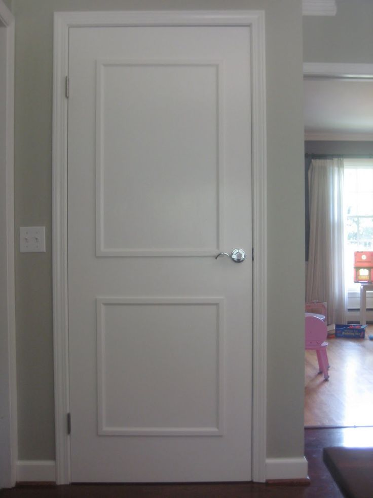 Adding Molding and paint to 60s brown FLAT plain interior doors  (jen's note:  sure it's cheap to just buy new white hollow core doors, but then u lose all the insulating powers of those original heavy solid doors....  Plus you still have to chisel out hinges and assemble doorknobs....)
