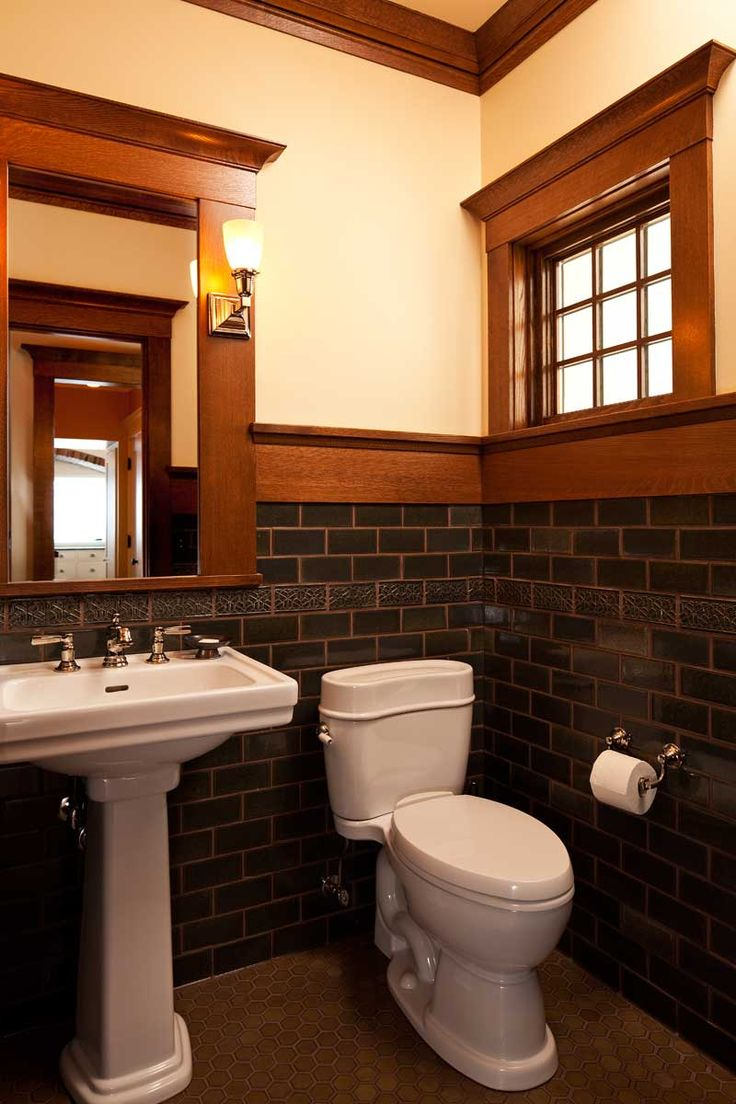WIth its richly-colored tile, the powder room has an Arts & Crafts feeling.